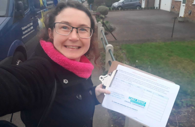 Carly knocking on doors with the Woodmere Avenue width restriction petition